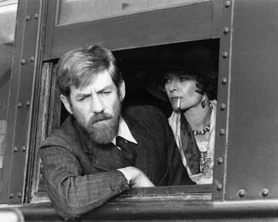 Frieda (Janet Suzman) and D. H. Lawrence (Ian McKellen) journeying by train to New Mexico