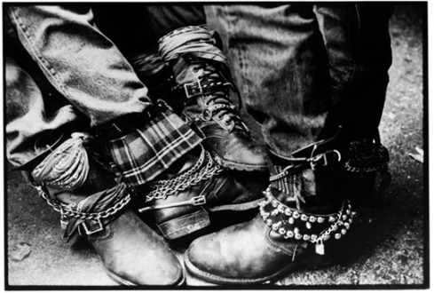 """Punk Boots at Oki Dogs, a hotdog place on Santa Monica Blvd. in Hollywood that was a popular after-show hangout in the late 70s/early 80s.  One of Darby Crash's typical end-of-show lines was """"See You All At Oki Dogs."""" He apparently said this the night of the last Germs show before he OD'd on heroin. Photo By Edward Colver. This photo was used on Bad Religion's """"80-85"""" Cover"""