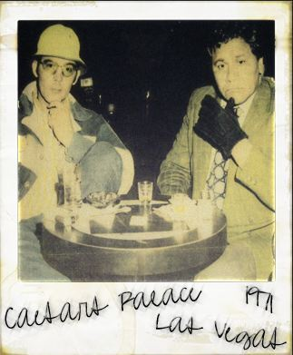 "Hunter S. Thompson and Oscar Zeta Acosta at Caesar's Palace, Las Vegas in 1971.  Thompson was supposed to be interviewing Acosta about the killing of LA Times journalist, Acosta's friend Ruben Salazar.  The scene in LA proved to be too chaotic so they purchased many drugs and left town for Las Vegas when Thompson was offered to cover a  March and April 1971 was when Thompson and Acosta made 2 separate trips to Vegas. Both of these trips made up the material for ""Fear and Loathing in Las Vegas."" Acosta was upset to be referred to as ""Samoan"" so he demanded this photo be included on the back cover of the book as well as asking for writing credit as much of the book was based on tape recorded conversations the pair had. ""The Gonzo Tapes"" contains one of these interviews"