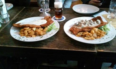Tale of two schnitzels. One is Weiner Art and one is Jager art. A Dusseldorf Alt stands proudly in its glass.